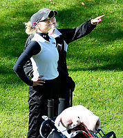 Middleton's Glenna Sanderson gets advice from her coach, Becky Halverson, during the Wisconsin WIAA state girls high school golf tournament on Monday, 10/14/19 at University Ridge Golf Course