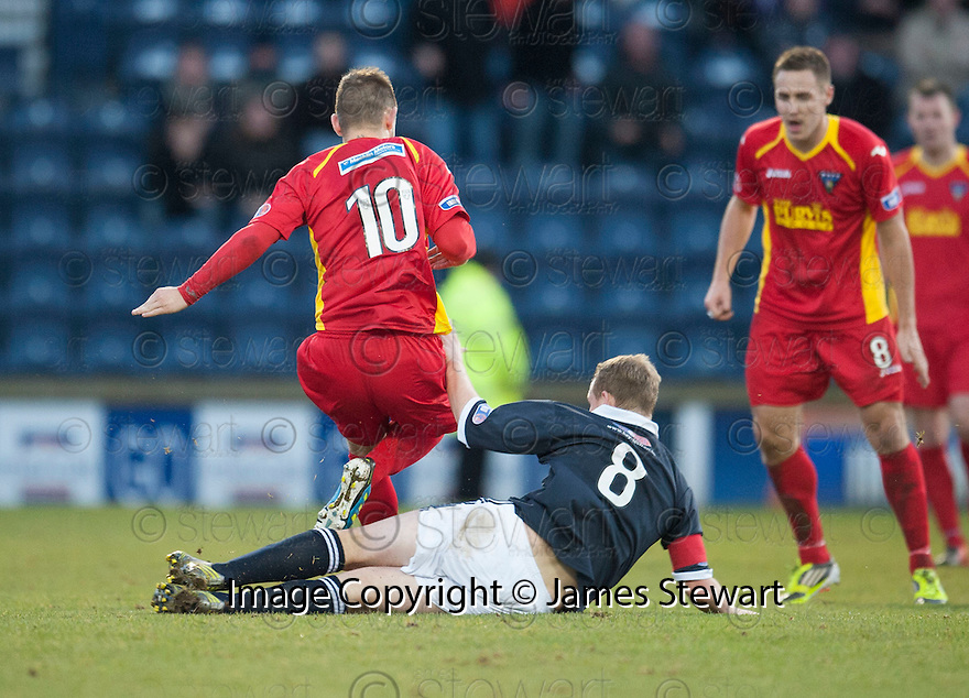 Raith's Allan Walker makes a two footed tackle on Pars' Ryan Wallace which resulted in a straight red ....