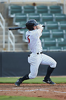 Ian Dawkins (6) of the Kannapolis Intimidators follows through on his swing against the West Virginia Power at Kannapolis Intimidators Stadium on July 25, 2018 in Kannapolis, North Carolina. The Intimidators defeated the Power 6-2 in 8 innings in game one of a double-header. (Brian Westerholt/Four Seam Images)