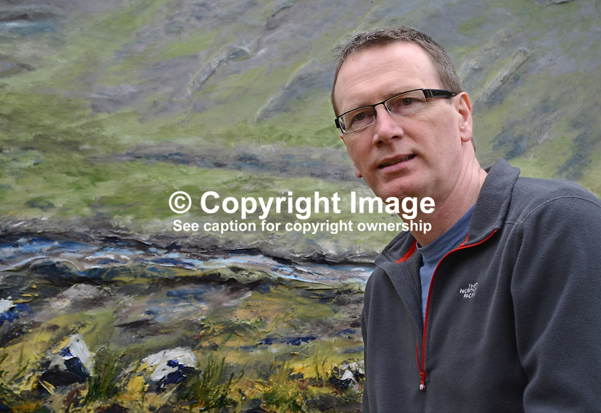 Keith Ayton, N Ireland artist, who is currently holding an exhibition in the Linen Hall Library, Belfast, N Ireland, which runs until the 30th March, 2013. Keith is a native of Derry/Londonderry but resident in Belfast. 201203041225..Copyright Image from Victor Patterson, 54 Dorchester Park, Belfast, UK, BT9 6RJ..Tel: +44 28 9066 1296.Mob: +44 7802 353836.Voicemail +44 20 8816 7153.Skype: victorpattersonbelfast.Email: victorpatterson@me.com.Email: victorpatterson@ireland.com (back-up)..IMPORTANT: If you wish to use this image or any other of my images please go to www.victorpatterson.com and click on the Terms & Conditions. Then contact me by email or phone with the reference number(s) of the image(s) concerned.