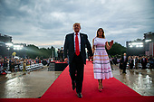 "U.S. President Donald Trump and first lady Melania Trump depart during the Fourth of July Celebration 'Salute to America' event in Washington, D.C., U.S., on Thursday, July 4, 2019. The White House said Trump's message won't be political -- Trump is calling the speech a ""Salute to America"" -- but it comes as the 2020 campaign is heating up.<br /> Credit: Al Drago / Pool via CNP"