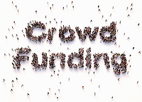 Overhead view of people forming words crowd funding