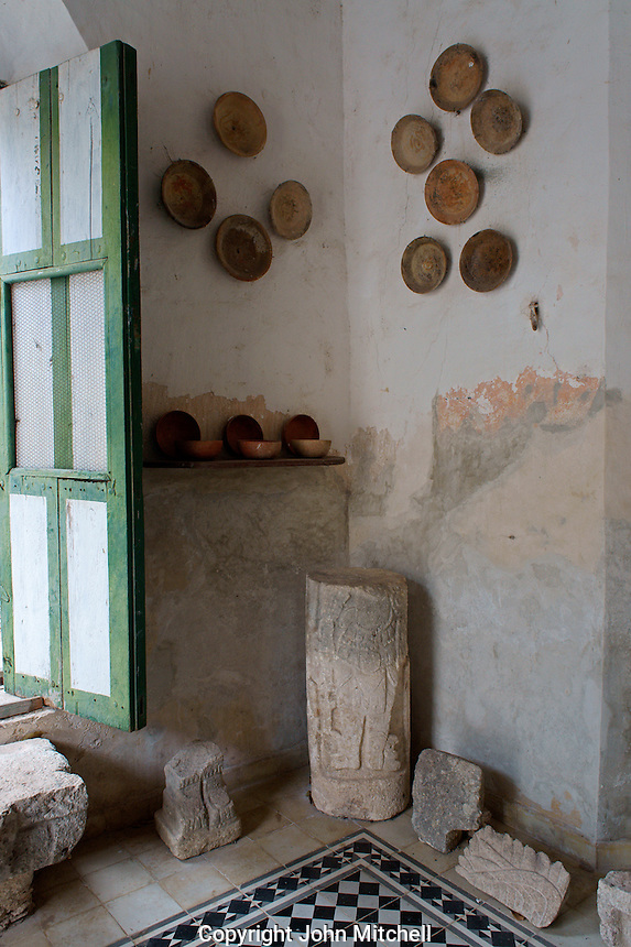Mayan artifacts from the archaeological site of Yaxcopoil in tha Maya Room at Hacienda Yaxcopoil, Yucatan, Mexico.