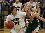 Spanish Springs guard Autumn Wadsworth (14) drives past Bishop Manogue Kylie deBruin (10) during a class 4A Northern Regional Girls Basketball Championship game Spanish Springs High School in Sparks, Nev., Saturday, Feb. 22, 2020.