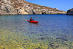 Kayaking shoreline clear blue sea water, Mgarr ix-Xini coastal inlet, island of Gozo, Malta