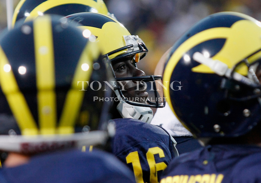 Michigan quarterback Denard Robinson (16) watches game action from the sideline late in the fourth quarter of an NCAA college football game with Iowa, Saturday, Oct. 16, 2010, in Ann Arbor, Mich. Robinson left the game early in the third quarter in Iowa's 38-28 win. (AP Photo/Tony Ding)