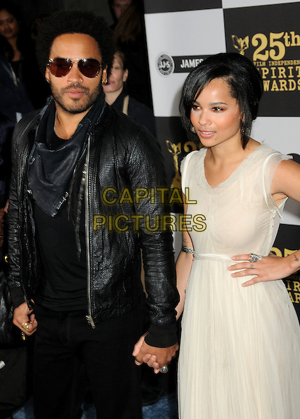 LENNY & ZOE KRAVITZ.25th Annual Film Independent Spirit Awards - Arrivals held at the Nokia Event Deck at L.A. Live, Los Angeles, California, USA..March 5th, 2010.half length jacket white beige cream dress sleeveless father dad daughter family black leather stubble beard facial hair sunglasses shades holding hands on hip.CAP/ADM/BP.©Byron Purvis/AdMedia/Capital Pictures.