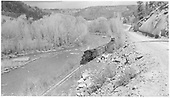 RGS #20 works a short freight along the Dolores River just north of the Muldoon siding.<br /> RGS  Muldoon, CO  Taken by Richardson, Robert W. - 5/23/1951