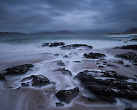 Flowing waves across small rocky beach, near Scarista, Isle of Harris, Scotland