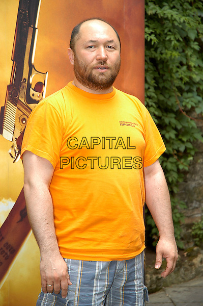 "TIMUR BEKMAMBETOV.Photocall for thhe film ""Wanted"", Rome, Italy..June 11th, 2008.director half length orange yellow t-shirt beard facial  hair .CAP/CAV.©Luca Cavallari/Capital Pictures."