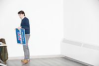 A man takes down Gillibrand 2020 campaign posters after Democratic presidential candidate Senator Kirsten Gillibrand (D-NY) spoke at a town hall campaign event at the Concord Parks and Recreation Community Center in Concord, New Hampshire, USA on Sat., Apr. 6, 2019.