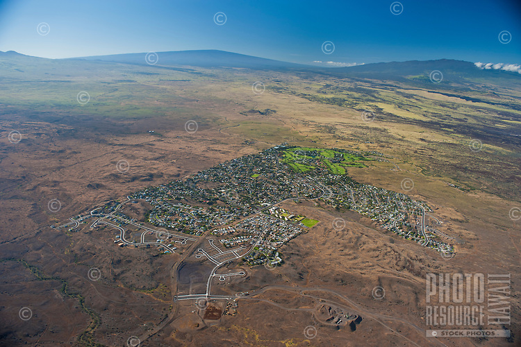 Aerial view of Waikoloa Village looking towards Hualalalai and Mauna Loa