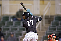 Micker Aldofo (27) of the Kannapolis Intimidators at bat against the Lakewood BlueClaws at Kannapolis Intimidators Stadium on April 6, 2017 in Kannapolis, North Carolina.  The BlueClaws defeated the Intimidators 7-5.  (Brian Westerholt/Four Seam Images)