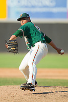 Alejandro Ramos #12 of the Greensboro Grasshoppers in action against the Hickory Crawdads at  L.P. Frans Stadium July 10, 2010, in Hickory, North Carolina.  Photo by Brian Westerholt / Four Seam Images