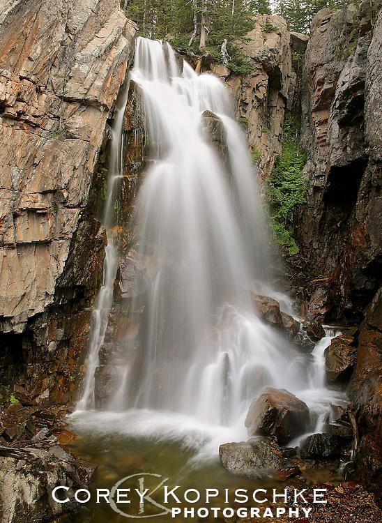 The Winter runoff spills over Gold Creek Falls in the Zirkel Wilderness.