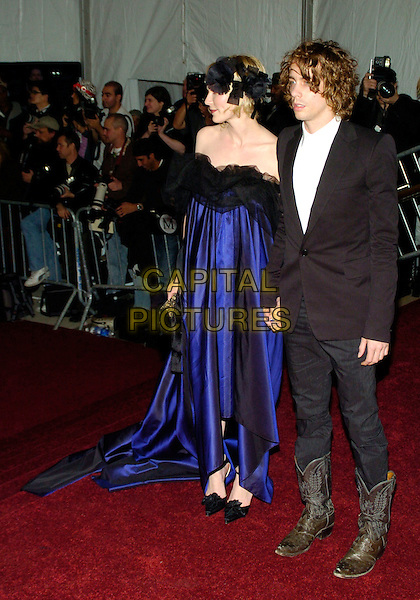 "KIRSTEN DUNST & JOHNNY BORRELL (RAZORLIGHT).2007 Metropolitan Museum of Art Costume Institute Gala celebrating ""Poiret: King of Fashion"" exibition at the Metropolitan Museum of Art, New York City, New York, USA..May 7th, 2007.full length purple blue dress black sheer chiffon off the shoulder headband suit jacket jeans denim cowboy boots holding hands couple .CAP/ADM/BL.©Bill Lyons/AdMedia/Capital Pictures *** Local Caption ***"