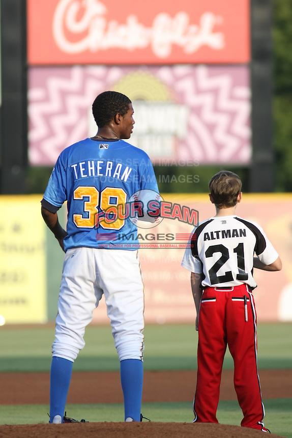 """Myrtle Beach Pelicans pitcher Julio Teheran #39 standing for the national anthem with a young player from the Pelican's """"Field of Dreams """" promotion before a game vs. the Potomac Nationals at BB&T Coastal Field in Myrtle Beach, SC, on June 16, 2010. The Nationals defeated the Pelicans 13-4. Photo By Robert Gurganus/Four Seam Images"""