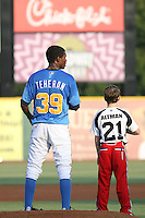 "Myrtle Beach Pelicans pitcher Julio Teheran #39 standing for the national anthem with a young player from the Pelican's ""Field of Dreams "" promotion before a game vs. the Potomac Nationals at BB&T Coastal Field in Myrtle Beach, SC, on June 16, 2010. The Nationals defeated the Pelicans 13-4. Photo By Robert Gurganus/Four Seam Images"