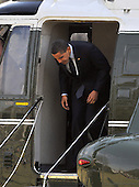 Washington, D.C. - March 6, 2009 -- United States President Barack Obama ducks his head as he prepares to leave Marine One after arriving on the South Lawn of the White House in Washington, D.C. on Friday, March 6, 2009 after making remarks at the Columbus (Ohio) Police Graduation Exercise..Credit: Ron Sachs / Pool via CNP