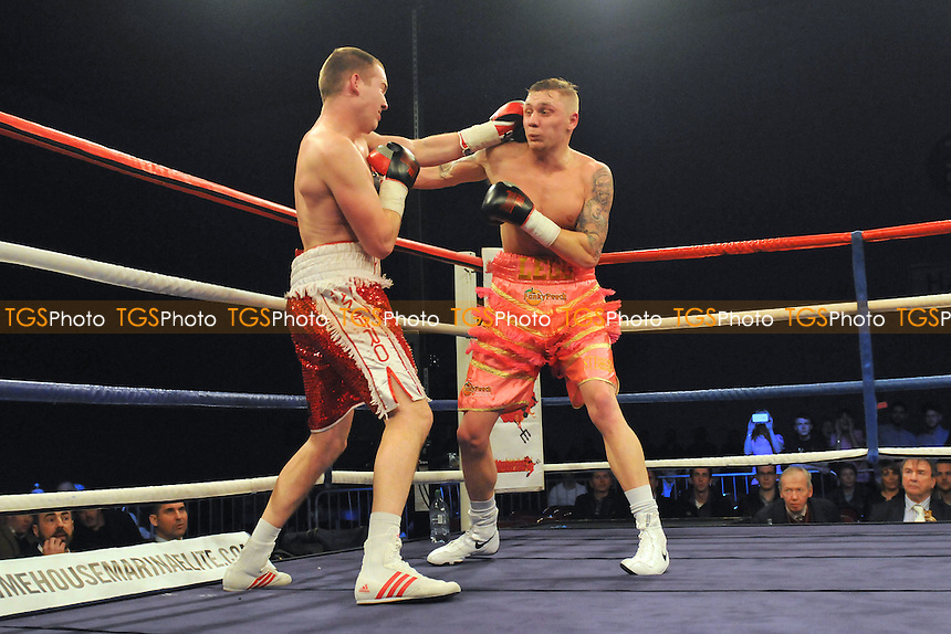 Gareth Piper (red/white shorts) defeats MH Legg - Boxing at the Leisure Centre, Harrow - 21/02/15 - MANDATORY CREDIT: Philip Sharkey/TGSPHOTO - Self billing applies where appropriate - contact@tgsphoto.co.uk - NO UNPAID USE