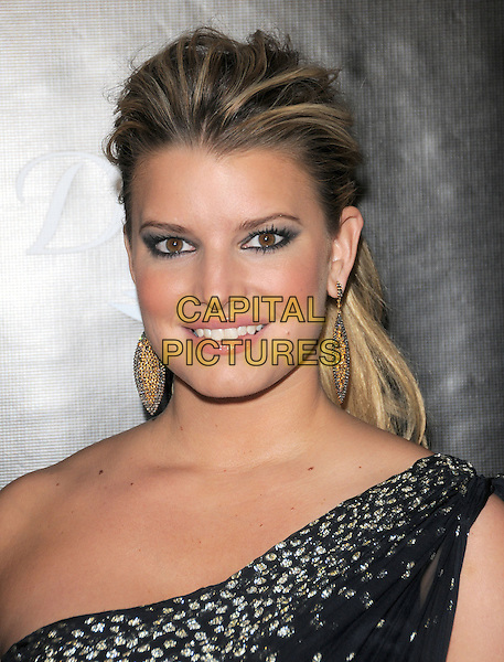 JESSICA SIMPSON.The Gracie Awards Gala held at The Beverly Hilton Hotel in Beverly Hills, California, USA..May 25th, 2010           .headshot portrait black one shoulder sheer gold silver dangling earrings beads beaded eyeliner eyeshadow make-up .CAP/RKE/DVS.©DVS/RockinExposures/Capital Pictures.