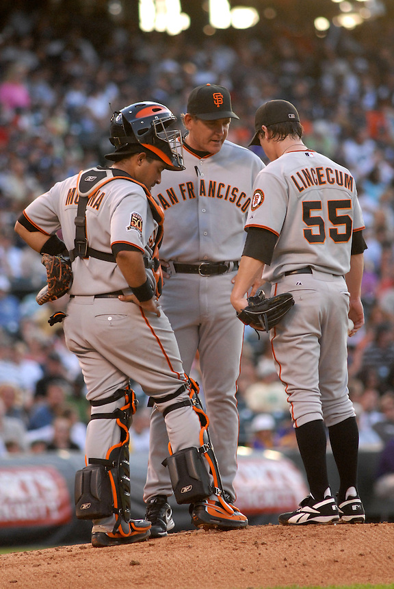 20 May 2008: Giants starting pitcher Tim Lincecum is visited on the mound by pitching coach Dave Righetti and catcher Bengie Molina during a regular season game between the San Francisco Giants and the Colorado Rockies at Coors Field in Denver, Colorado. The Giants beat the Rockies 6-5. *****For editorial use only*****