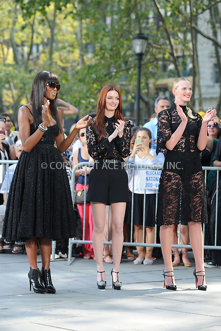 WWW.ACEPIXS.COM<br /> September 11, 2013 New York City<br /> <br /> Naomi Campbell, Lydia Hearst, Anne Vyalitsyna taping a segment for 'The Face' in Bryant Park on September 11, 2013 in New York City.<br /> <br /> By Line: Kristin Callahan/ACE Pictures<br /> <br /> ACE Pictures, Inc.<br /> tel: 646 769 0430<br /> Email: info@acepixs.com<br /> www.acepixs.com<br /> Copyright:<br /> Kristin Callahan/ACE Pictures