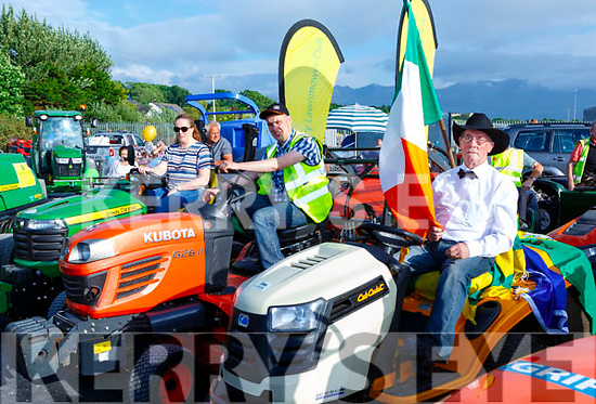 Eilish Doyle , Anthony Boon and Frank Cronin revving up at the start of the Lawnmower run in Killorglin on Friday evening