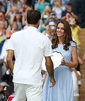 Roger Federer of Switzerland is presented with the runners-up trophy by Catherine, Duchess of Cambridge<br /> <br /> <br /> Photographer Rob Newell/CameraSport<br /> <br /> Wimbledon Lawn Tennis Championships - Day 13 - Sunday 14th July 2019 -  All England Lawn Tennis and Croquet Club - Wimbledon - London - England<br /> <br /> World Copyright © 2019 CameraSport. All rights reserved. 43 Linden Ave. Countesthorpe. Leicester. England. LE8 5PG - Tel: +44 (0) 116 277 4147 - admin@camerasport.com - www.camerasport.com