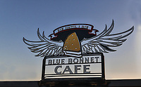 Blue Bonnet cafe sign  in parking lot that says Pie until I Die!  Make sure and stop by for some pie while in Marble Falls this is the place to eat a good meal and top it off with some pie, I like that!