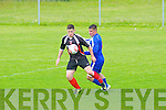 Tralee Dynamos Chris Kerins gets away from Shanakill Athletic's Stefan O'Shea in the Tommy Healy Cup Final at Mounthawk Park, Tralee on Sunday.