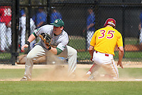 Slippery Rock Jamison Walck #5 gets a throw as Josh Logan #35 slides into third during a game vs. the Seton Hill Griffins at Lake Myrtle Field in Auburndale, Florida;  March 5, 2011.  Seton Hill defeated Slippery Rock 14-1.  Photo By Mike Janes/Four Seam Images