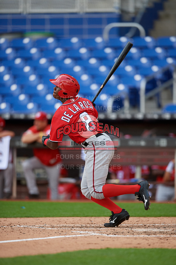 Washington Nationals Jeremy De La Rosa (8) follows through on a swing during a Florida Instructional League game against the Miami Marlins on September 26, 2018 at the Marlins Park in Miami, Florida.  (Mike Janes/Four Seam Images)
