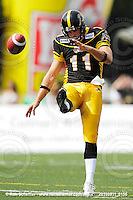 September 11, 2010; Hamilton, ON, CAN; Hamilton Tiger-Cats punter Eric Wilbur (11). CFL football: Montreal Alouettes vs. Hamilton Tiger-Cats at Ivor Wynne Stadium. The Alouettes defeated the Tiger-Cats 27-6. Mandatory Credit: Ron Scheffler. Copyright (c) 2010 Ron Scheffler.