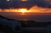 Sun breaking through clouds with buildings in the foreground, San Miguel, Tenerife, Canary Islands