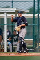 GCL Yankees East catcher Alex Guerrero (49) signals to the defense during the first game of a doubleheader against the GCL Pirates on July 31, 2018 at Pirate City Complex in Bradenton, Florida.  GCL Yankees East defeated GCL Pirates 2-0.  (Mike Janes/Four Seam Images)