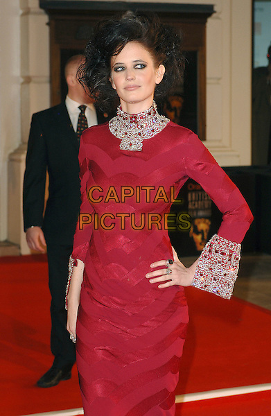 EVA GREEN.Arriving at the 2007 Orange British Academy Film Awards (BAFTAs) at the Royal Opera House, London, England, 11th February 2007..half 3/4 length hand on hip black dress big hair silver jewel encrusted cuffs collar.CAP/ BEL.©Tom Belcher/Capital Pictures.