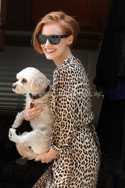 WWW.ACEPIXS.COM....July 23 2012, New York City....Jessica Chastain with her dog Chaplain on the set of the new movie 'The Disappearance of Eleanor Rigby' film set on July 23, 2012 in New York City....By Line: Zelig Shaul/ACE Pictures......ACE Pictures, Inc...tel: 646 769 0430..Email: info@acepixs.com..www.acepixs.com