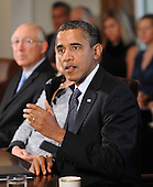 United States President Barack Obama speaks at a Cabinet Meeting in the Cabinet Room at the White House in Washington, DC., Monday, October 3, 2011.  U.S. Secretary of the Interior Ken Salazar is in the background at left..Credit: Olivier Douliery / Pool via CNP