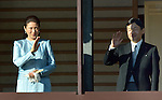 January 2, 2014, Tokyo, Japan - Crown Prince Naruhito and his wife, Princess Masako, wave to a throng of well-wishers during a New Year's general audience at the Imperial Palace in Tokyo on Thursday, January 2, 2014. More than 80,000 well-wishers turned out to celebrate the coming of the new year with the imprerial family who made five appearances on the palace balcony. (Photo by Natsuki Sakai/AFLO) AYF -mis-