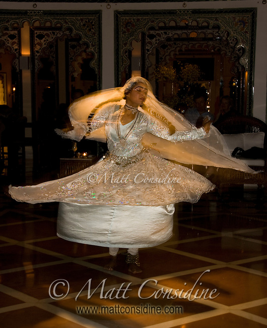 The dancer spins faster and faster as the music speeds up and reaches a crescendo.<br /> (Photo by Matt Considine - Images of Asia Collection)