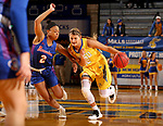 BROOKINGS, SD - NOVEMBER 1: Macy Miller #12 from South Dakota State drives to the basket against Christal Hearn #2 from the University of Mary during their exhibition game Thursday night at Frost Arena in Brookings. (Photo by Dave Eggen/Inertia)