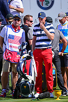 Daniel Berger (USA) blows on his ball on the first tee during round 4 Singles of the 2017 President's Cup, Liberty National Golf Club, Jersey City, New Jersey, USA. 10/1/2017. <br /> Picture: Golffile | Ken Murray<br /> <br /> All photo usage must carry mandatory copyright credit (&copy; Golffile | Ken Murray)