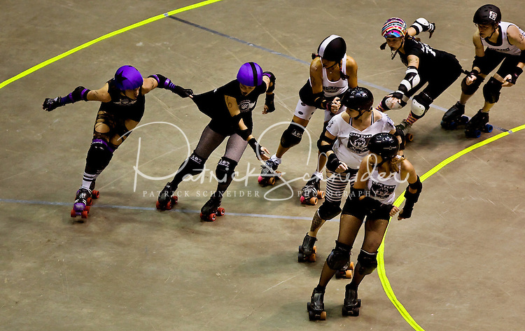 Roller girls skate during a Charlotte Roller Derby Girls event at Bojangles Arena in Charlotte, NC.