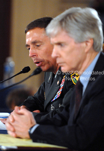 Washington, D.C. - September 10, 2007 -- United States Army General David H. Petraeus, Commander of the Multi-National Force - Iraq (MNF-I), left, and Ryan Crocker, United States Ambassador to Iraq, testify on the future course of the war in Iraq while appearing before a joint hearing of the United States House Armed Services Committee and United States House Foreign Relations Committee, Monday, September 10, 2007, on Capitol Hill in Washington..Credit: Ron Sachs / CNP