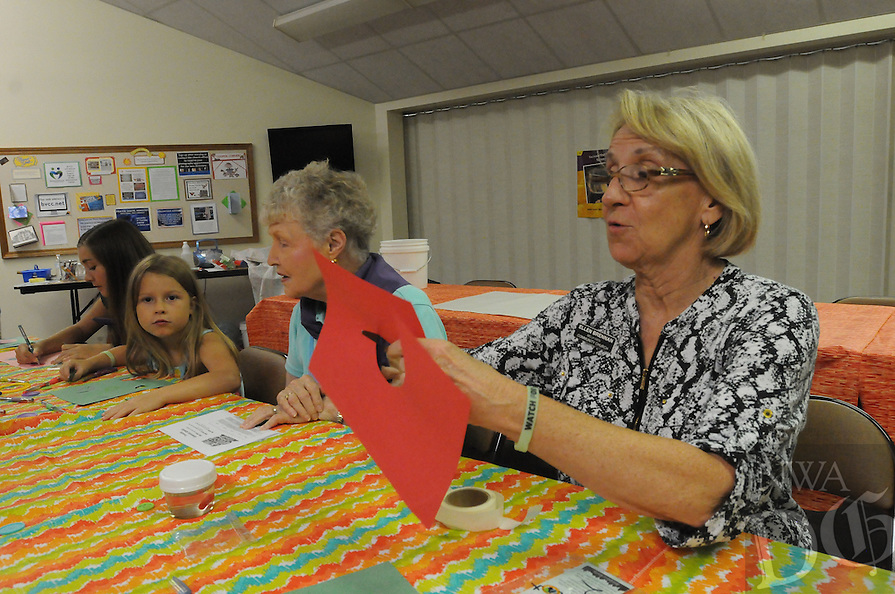 NWA Democrat-Gazette/FLIP PUTTHOFF <br /> CAVE QUEST VBS<br /> Charlene Bauer (second from right) and Ellen Brennan, (right) help youngsters with crafts Tuesday July 26, 2016 during vacation bible school at Bella Vista Community Church. The event was geared for students 4 years old through grade 6, said Pastor Anna Teel. &quot;Cave Quest&quot; was the theme of vacation bible school. Youths took part in singing, games, and crafts.