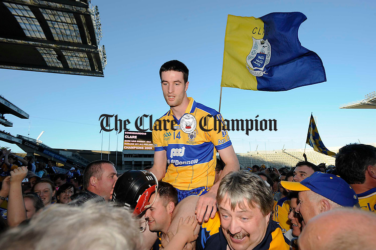 Clare's Darach Honan is carried shoulderhigh to the cup presentation area after their U-21 GAA All-Ireland final at Croke Park. Photograph by John Kelly.