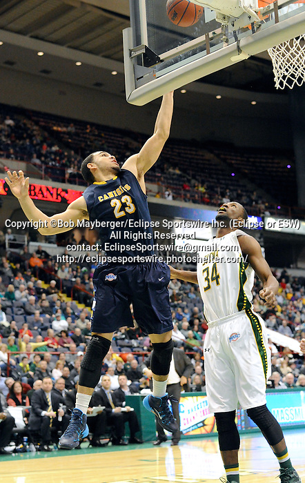 Game action from a Metro Atlantic Athletic Conference game which saw Canisius defeat Siena 92-88 in triple overtime on February 16, 2014 at the Times Union Center in Albany, New York.  (Bob Mayberger/Eclipse Sportswire)