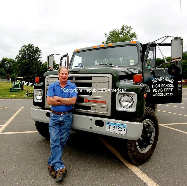 Woodbury, CT-17, June 2010-061710CM02  Alex Thomson stands next to a new Vo-Ag truck outside Nonnewaug High School. Thomson, a long time fixture at the school will be retiring at the end of this month.   --Christopher Massa Republican-American