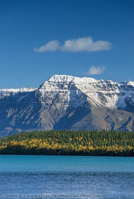 Aqua blue waters of Naknek Lake and snow covered Mt. Katolinat, Katmai National Park, Alaska.